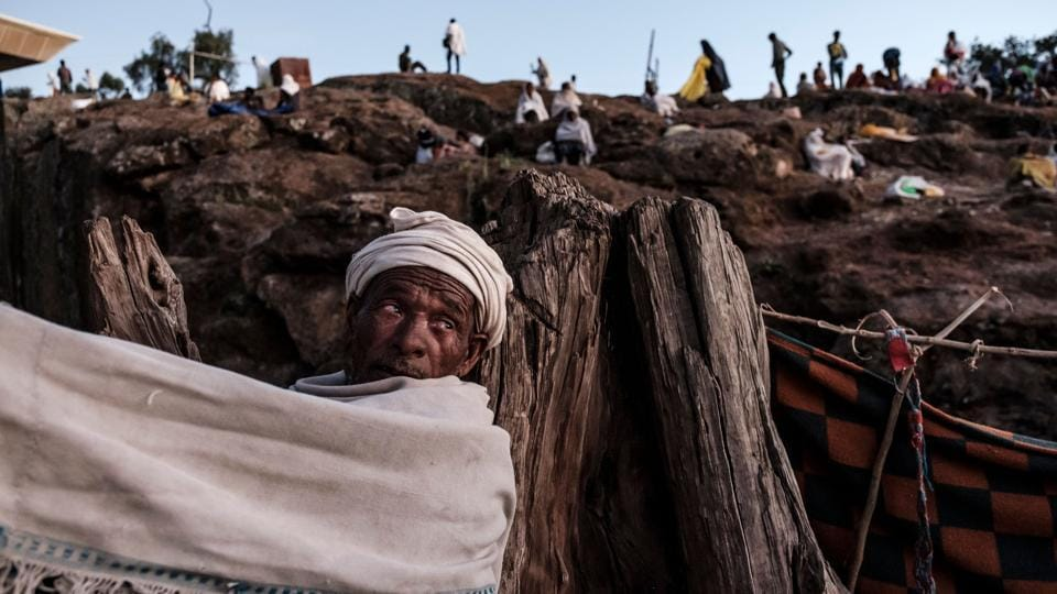 Ethiopian Orthodox pilgrims rest at one of pilgrim camp sites in Lalibela, Ethiopia. The Ethiopian Orthodox Christmas called Ledet or Genna celebrated on January 7 attracted pilgrims from all over the country. (Eduardo Soteras / AFP)