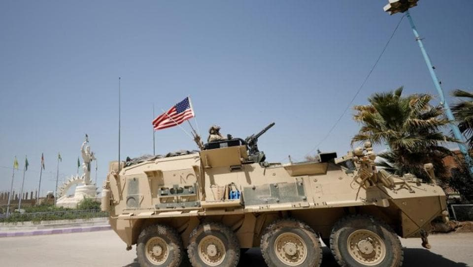 A US military vehicle travels in the town of Amuda, northern Syria April 29, 2017.