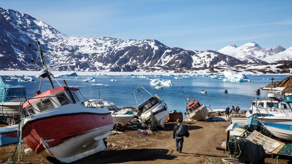 "Julius Nielsen, 40, who lives about 45 km from Tasiilaq, has been hunting and fishing in the area most of his life. ""There's no snow, it's too hot and the water is not freezing,"" Nielsen said. A thin, frail ice sheet - or lack of ice - pose a big problem for locals like Nielsen who are not able to go hunting with their sled dogs, or have to take alternate routes. (Lucas Jackson / REUTERS)"