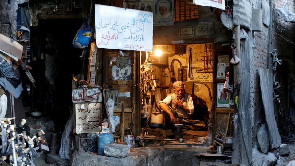 A blacksmith sits in his shop at the Souq al-Melh market in the old quarter of Sanaa, Yemen. (Khaled Abdullah / REUTERS)