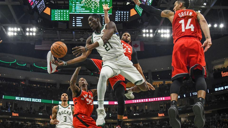 Milwaukee Bucks guard Tony Snell (21) takes a shot in the third quarter against Toronto Raptors guard Delon Wright (55) and guard Danny Green (14) at the Fiserv Forum in Milwaukee, Wisconsin. (Benny Sieu / USA Today via REUTERS)