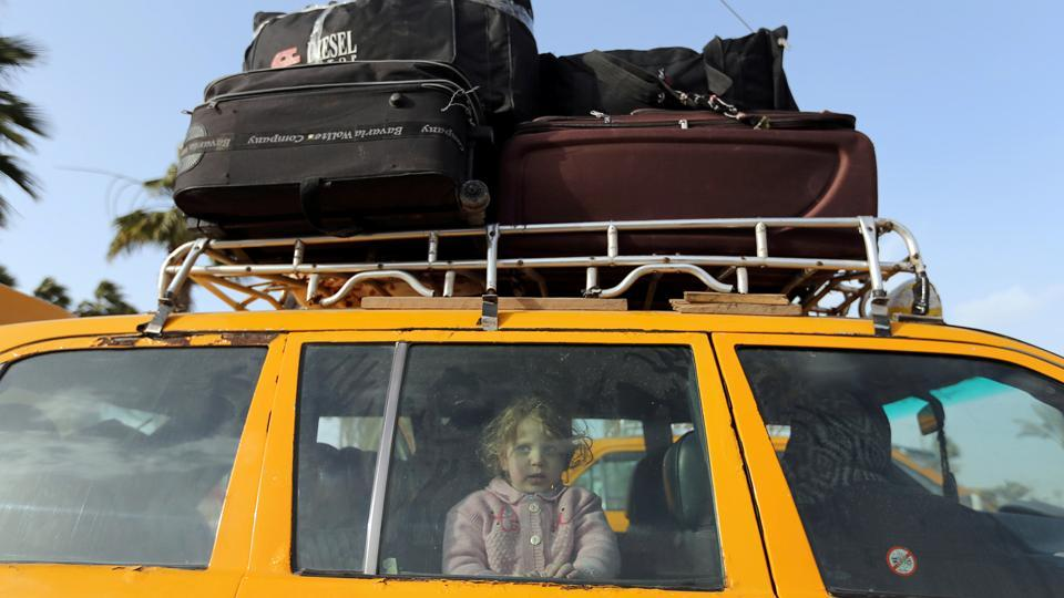 A Palestinian girl looks out of a car upon her return with her family to Gaza, at Rafah border crossing in the southern Gaza Strip. (Ibraheem Abu Mustafa / REUTERS)