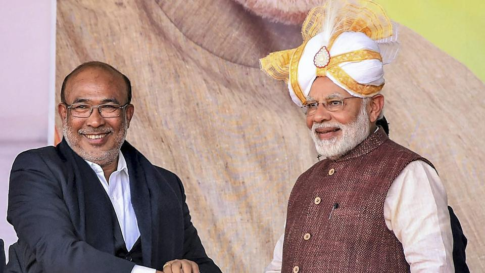Imphal: Prime Minister Narendra Modi shakes hands with Manipur Chief Minister N Biren Singh during the launch of development projects, in Imphal, Friday, Jan 4, 2019. (PTI Photo) (PTI1_4_2019_000175B)