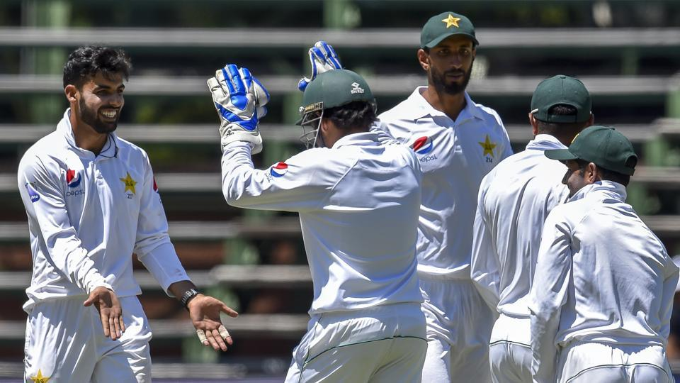 Pakistan's bowler Shadab Khan, left, celebrates with his captain Pakistan's wicket keeper Sarfraz Ahmed after the wicket of South Africa's batsman Hashim Amla on day one of the third cricket Test match