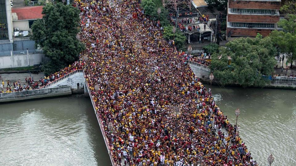 Devotees carry the statue of the Black Nazarene to the carriage at the start of the annual religious procession in Manila, Philippines. Throngs of believers flung themselves at a historic statue of Jesus Christ as it inched through Manila for an annual procession that is one of the world's biggest shows of Catholic zeal. (Noel Celis / AFP)