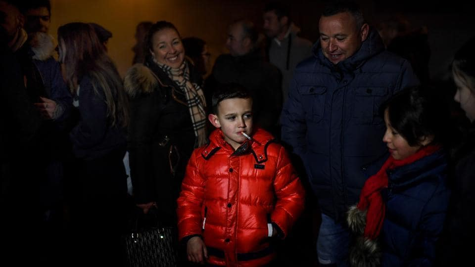 A child stands with other villagers as he smokes a cigarette during Epiphany celebrations in Vale de Salgueiro, northern Portugal. In the village of Vale de Salgueiro children as young as five are allowed to smoke cigarettes according to the local tradition of the Christian Epiphany celebrations. (Patricia De Melo Moreira / AFP)