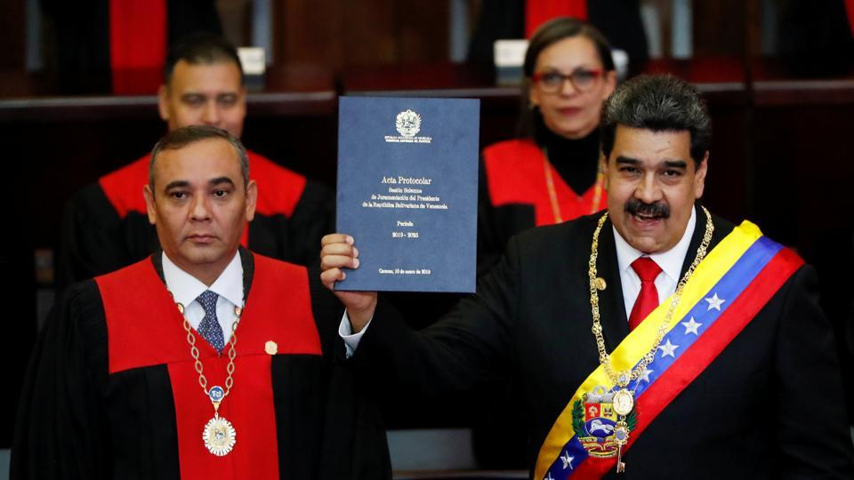 Venezuela's President Nicolas Maduro is sworn in by Venezuela's Supreme Court President Maikel Moreno, during the ceremonial swearing-in for his second presidential term, at the Supreme Court in Caracas, Venezuela. (Carlos Garcia Rawlins / REUTERS)