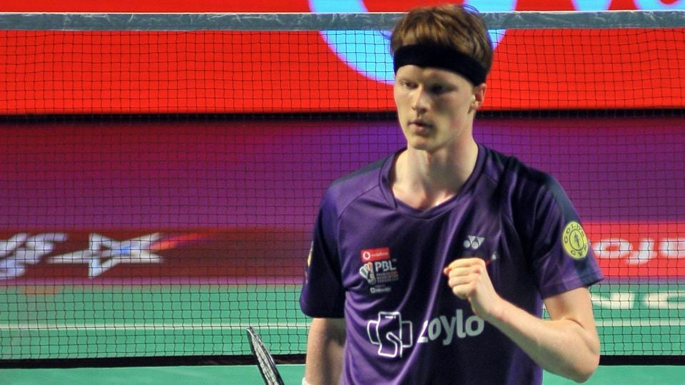 Anders Antonsen celebrates after winning a point against Lee Hyun.