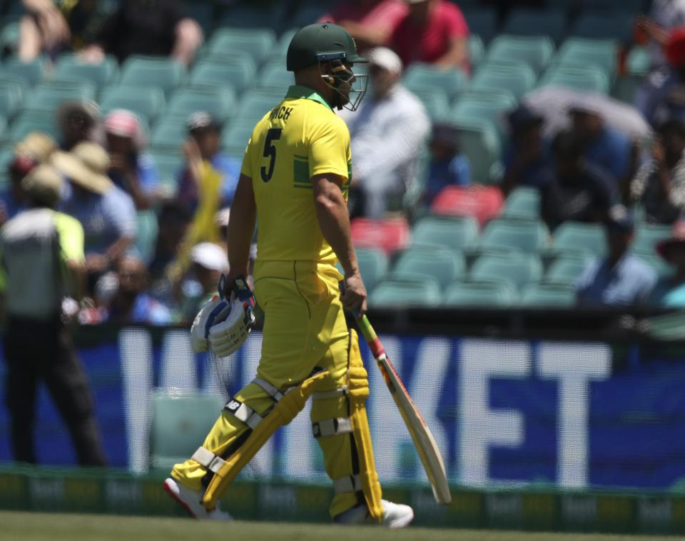 Australia's Aaron Finch walks off after he was bowled by India during their one day international cricket match in Sydney. (AP)