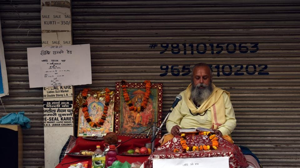 Pandit Lakshmi Narayan seen performing puja to stop sealing drive, at Amar Colony, in New Delhi, India, on Friday, January 11, 2019.