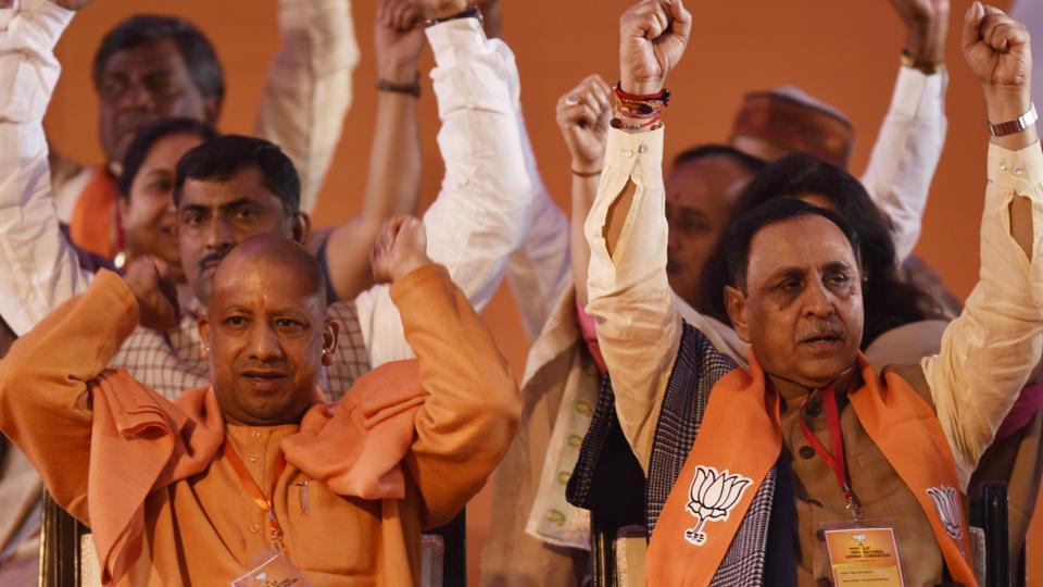 Uttar Pradesh CM Yogi Adityanath along with Gujarat CM  Vijay Rupani at the BJP national executive meet in New Delhi.
