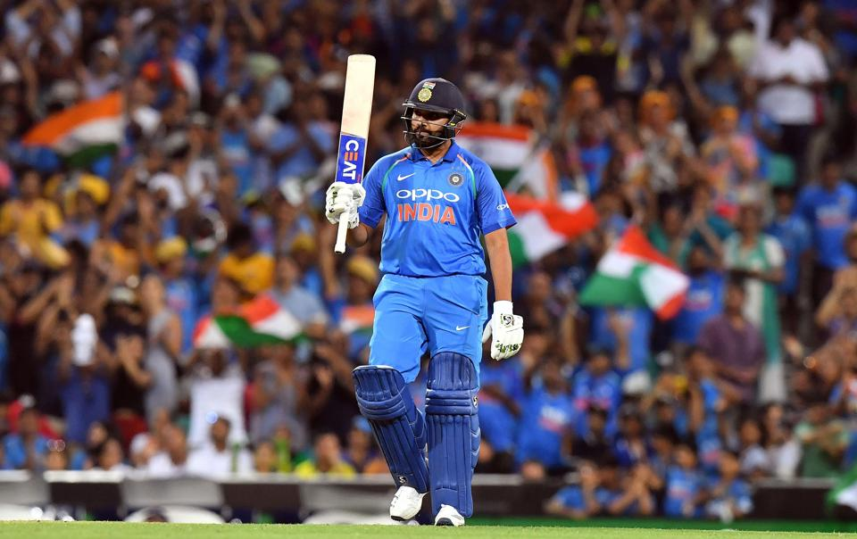 India's batsman Rohit Sharma celebrates scoring 100 runs to reach a century during the first one-day international (ODI) match between Australia and India at the Sydney Cricket Ground. (AFP)