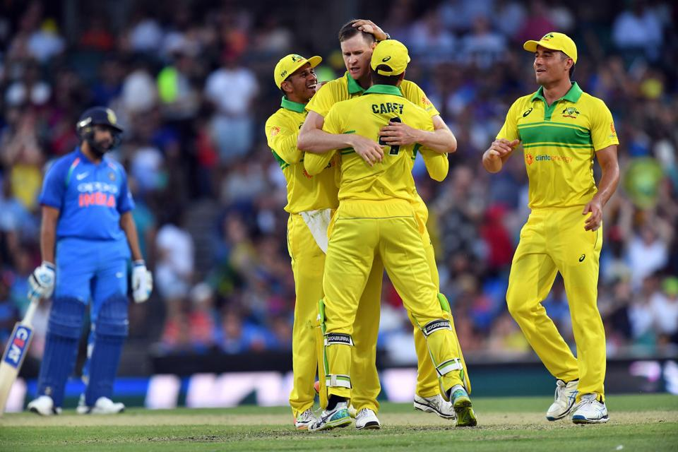Australia's Jason Behrendorff (C) celebrates taking the wicket of India's Mahendra Singh Dhoni during the first one-day international (ODI) match between Australia and India at the Sydney Cricket Ground. (AFP)