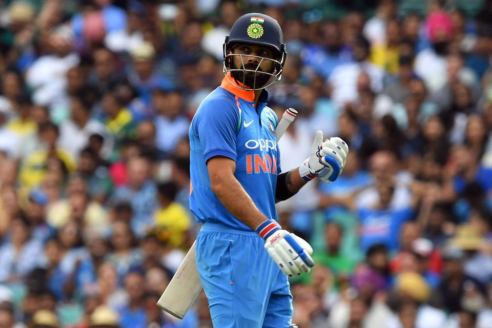 India's captain Virhat Kohli walks back to the pavilion after his dismissal during the first one-day international (ODI) match between Australia and India at the Sydney Cricket Ground. (AFP)