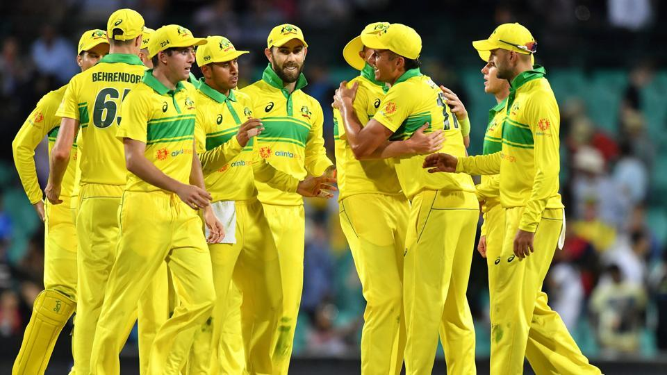 Australia's players celebrate their victory over India in the first one-day international (ODI) match at the Sydney Cricket Ground. (AFP)