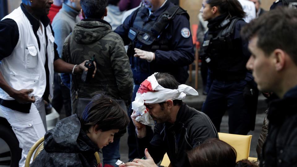 An injured man is treated after the explosion of a bakery on the corner of the streets Saint-Cecile and Rue de Trevise in central Paris on January 12, 2019.