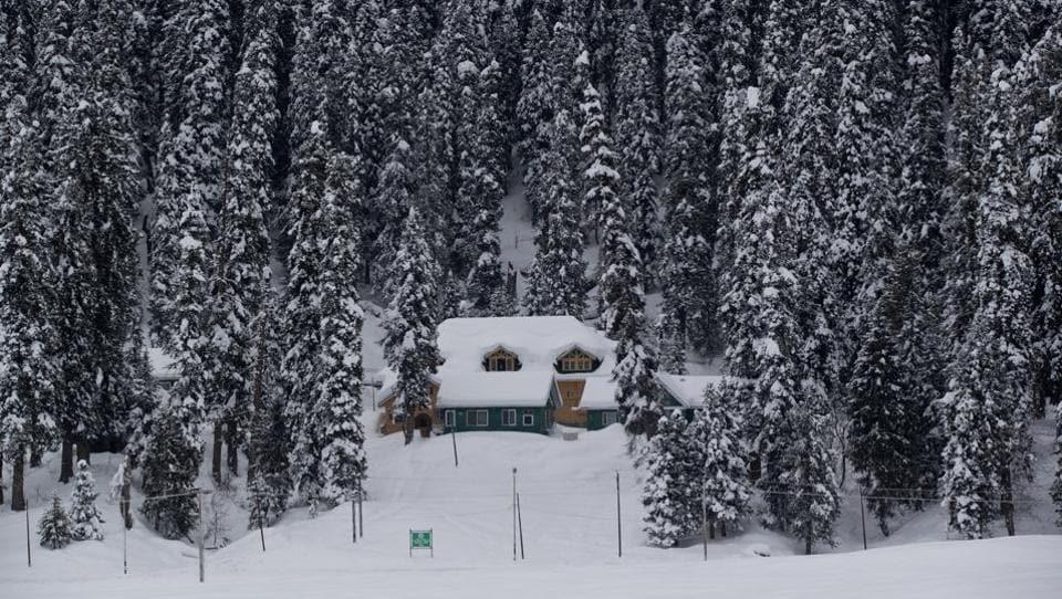 A view of a snow covered hut in Gulmarg, 55 kilometers north of Srinagar, Jammu and Kashmir. (Dar Yasin / AP)