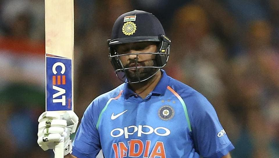 Rohit Sharma raises his bat after scoring a century against Australia.