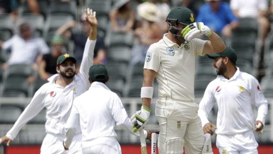 South Africa's batsman Dean Elgar, front, reacts as Pakistan players celebrates his wicket during day two of the third cricket test match between South Africa and Pakistan.