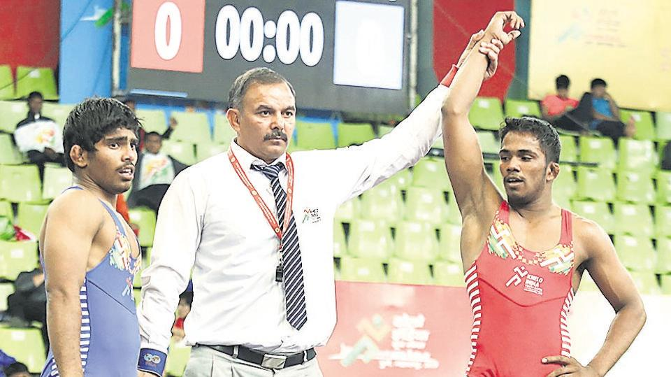 Sachin Datal (red) beat Haryana's Jaideep in the 60kg under-17 freestyle event at Khelo India Youth Games 2019 held at Shiv Chhatrapati sports complex, Balewadi on Friday.