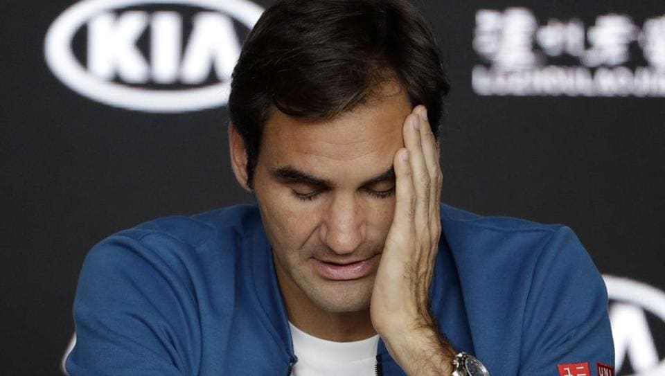 Men's defending singles champion Switzerland's Roger Federer reacts during a press conference at the Australian Open tennis championships in Melbourne, Australia, Sunday, Jan. 13, 2019