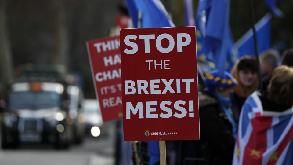 Pro-European demonstrators protest outside parliament in London, Friday, Jan. 11, 2019. Britain's Prime Minister Theresa May is struggling to win support for her Brexit deal in Parliament. Lawmakers are due to vote on the agreement Tuesday, and all signs suggest they will reject it, adding uncertainty to Brexit less than three months before Britain is due to leave the EU on March 29. (AP Photo/Frank Augstein)