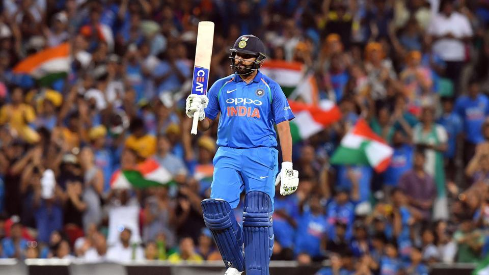 India's batsman Rohit Sharma celebrates scoring 100 runs to reach a century during the first one-day international (ODI)