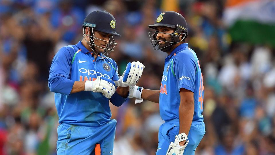 Mahendra Singh Dhoni (left) and Rohit Sharma speak during their partnership in the first ODI at the Sydney Cricket Ground.