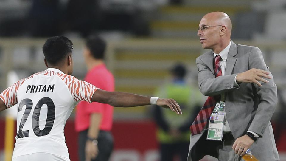 India's defender Pritam Kotal, left, celebrates with India's head coach Stephen Constantine during the AFC Asian Cup group A soccer match between Thailand and India.
