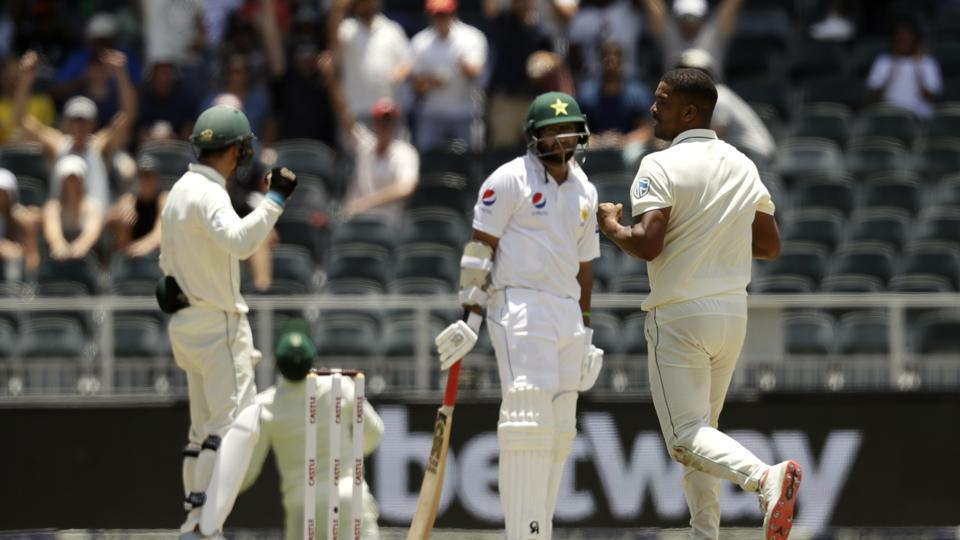 South Africa's bowler Vernon Philander, right, reacts after dismissing Pakistan's batsman Azhar Ali, middle, for a duck on day two of the third cricket test match between South Africa and Pakistan