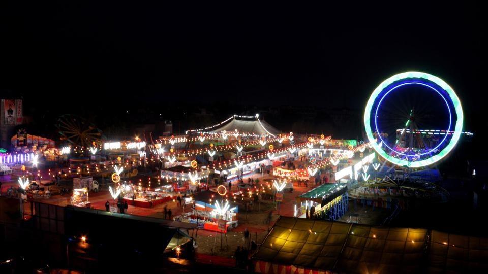 Visitors enjoy rides at the Meghi Mela on the eve of Makar Sankranti at Sri Muktsar Sahib, Punjab, India on Sunday.