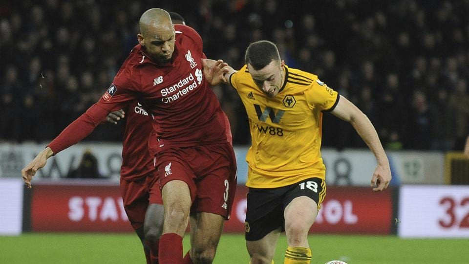 Liverpool's Fabinho, left, competes for the ball with Wolverhampton's Diogo Jota.