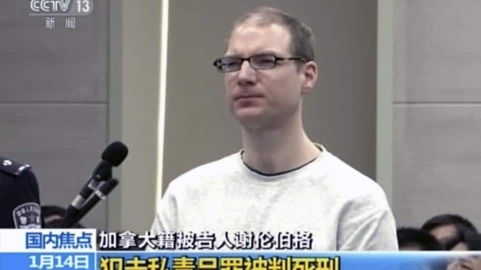 In this image taken from a video footage run by China's CCTV, Canadian Robert Lloyd Schellenberg attends his retrial at the Dalian Intermediate People's Court in Dalian, northeastern China's Liaoning province on January 14.