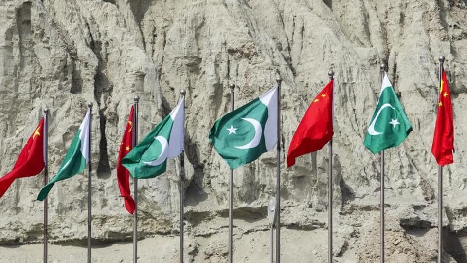 Chinese national flags fly next to Pakistani national flags at the Gwadar port in Gwadar, in Balochistan, Pakistan, on Tuesday, July 4, 2018.