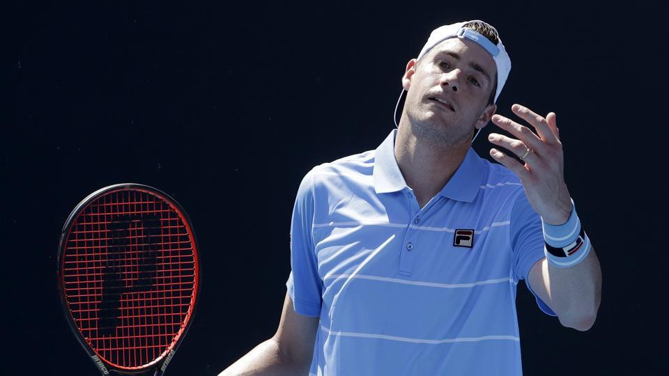 United States' John Isner reacts during his first round match against compatriot Reilly Opelka at the Australian Open.