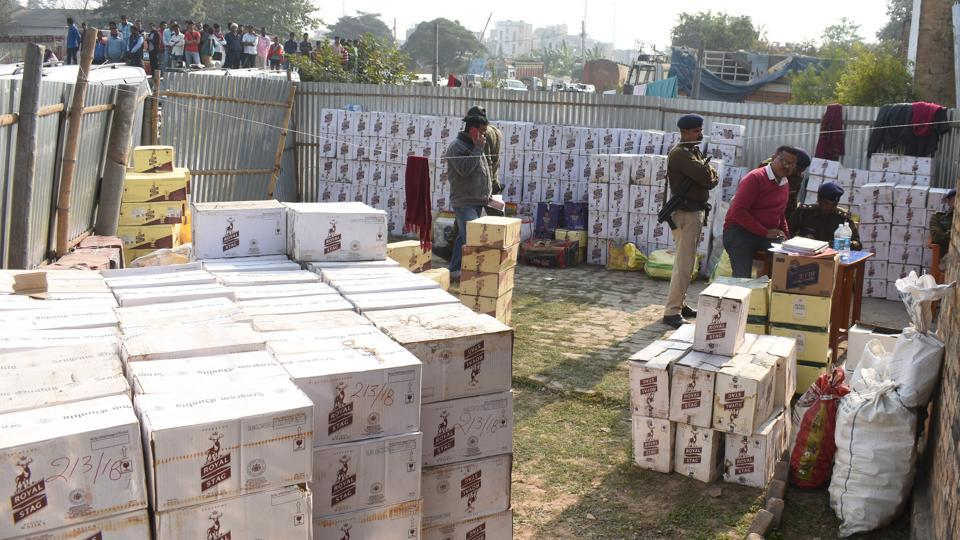 More than 300 cartons of liquor were recovered from SHO Amitabh Kumar's house