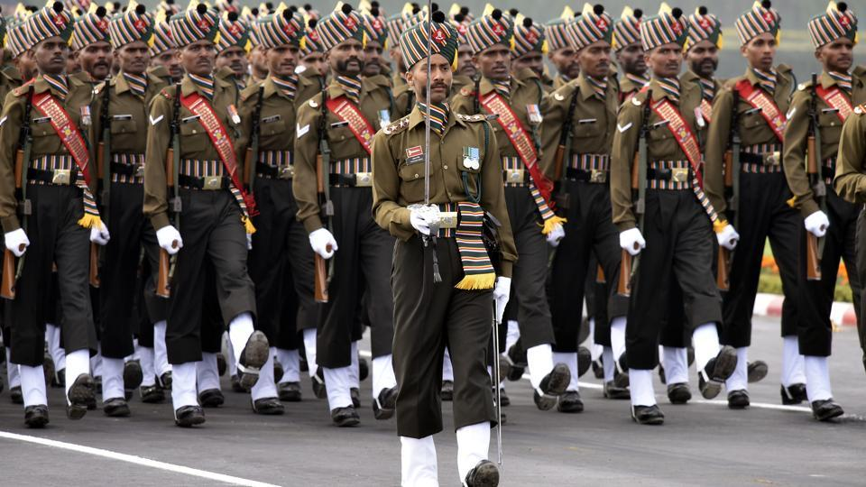 "Army soldiers march past during the Army Day Parade at Carriappa Parade Ground in New Delhi. On Tuesday, Prime Minister Narendra Modi greeted soldiers on the occasion of Army Day, saying the nation is proud of their grit and determination. ""I bow to their courage and bravery,"" he tweeted. (Vipin Kumar / HT Photo)"