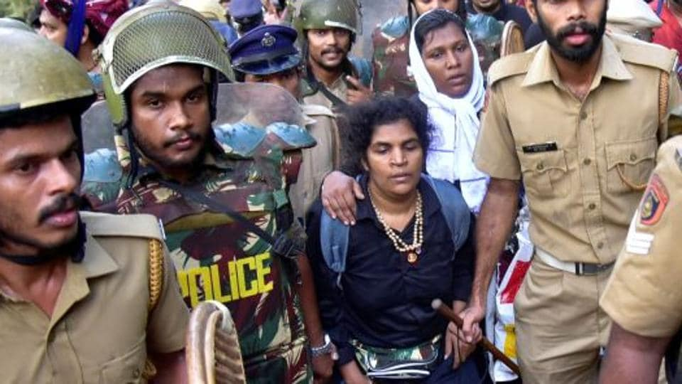 In the file photo, Kanaka Durga, 44, are escorted by police after she attempted to enter the Sabarimala temple in Pathanamthitta district in the southern state of Kerala, India, December 24, 2018. Picture taken December 24, 2018.