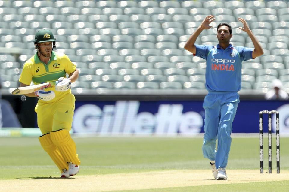 India's Bhuvneshwar Kumar, right, reacts during their one day international cricket match against Australia in Adelaide. (AP)