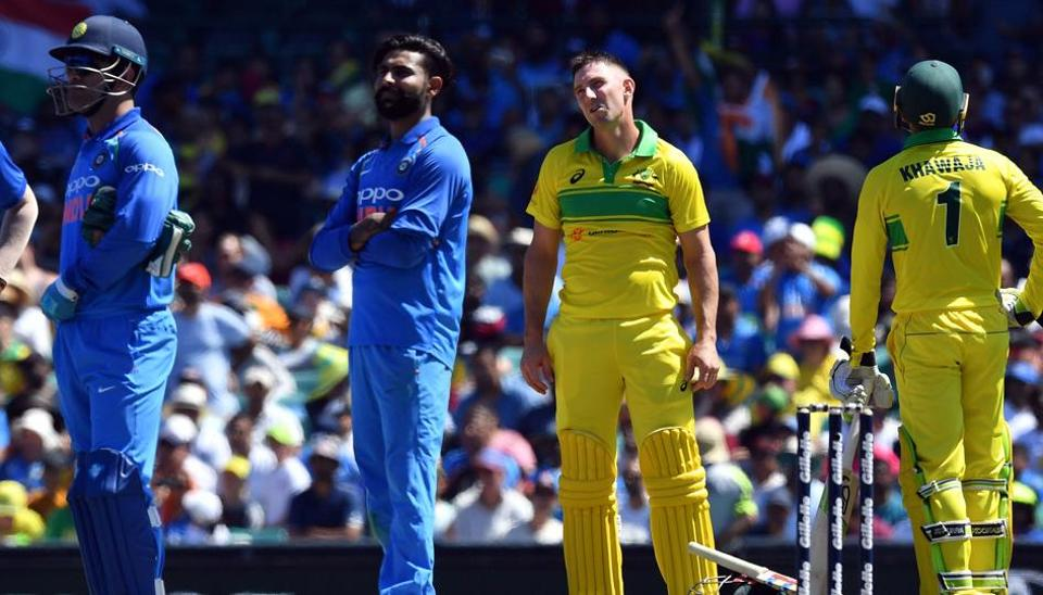 India's Ravindra Jadeja (2nd L) waits for a leg before wicket decision against Australia's batsman Usman Khawaja (R) as Shaun Marsh (2nd R) looks on during the first one-day International