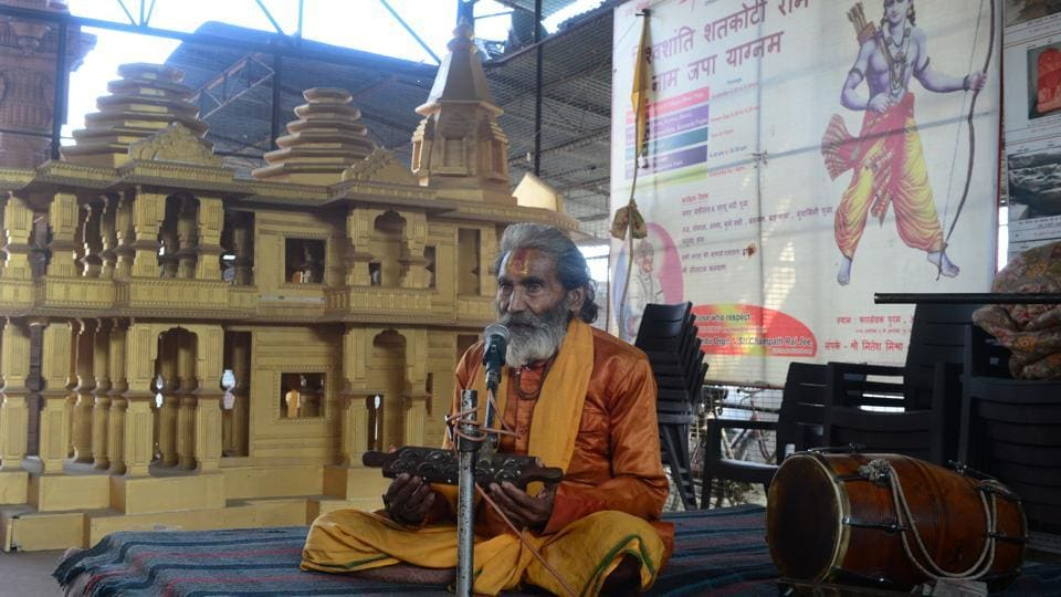 A sadhu worships as he sits next to a model of the proposed temple at Ram Janmabhoomi Nyas workshop in Ayodhya, Uttar Pradesh. Young and unemployed, Som Shekhar pines less for a job than the construction of the controversial temple -- and, as India's general election approaches, says he will vote for the only man he believes can deliver it. (Sanjay Kanojia / AFP)