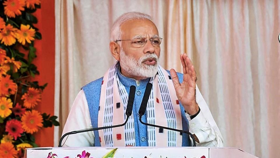 Prime Minister Narendra Modi addresses during the inauguration of various projects in Balangir, Odisha. Modi has also inaugurated renovation and restoration works of the Nilamadhav and Siddheswar temples there. (PTI)