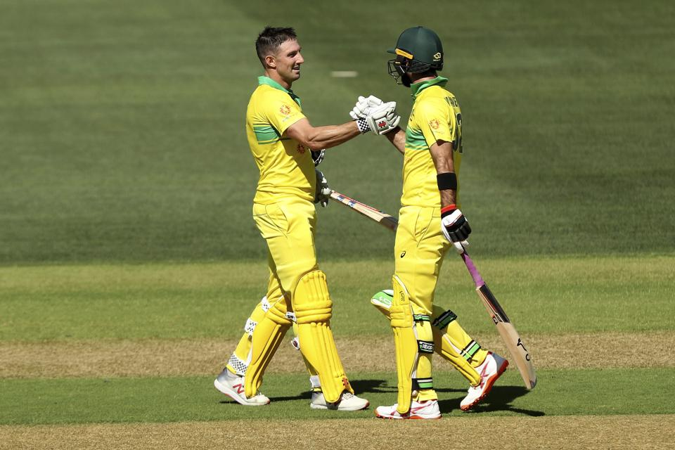 Australia's Shaun Marsh, left, celebrates his century with Glenn Maxwell during their one day international cricket match against Australia in Adelaide. (AP)