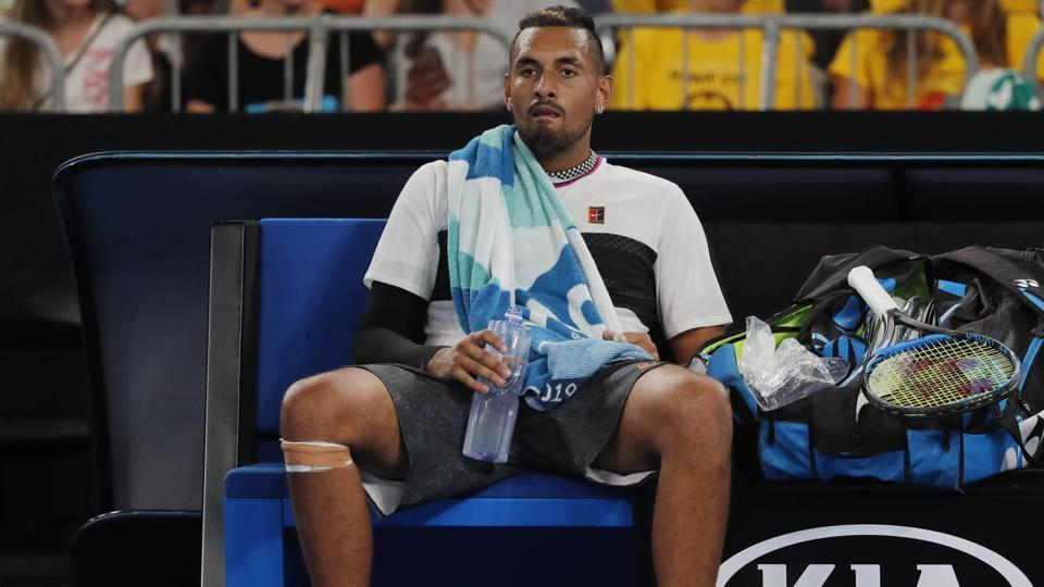 Nick Kyrgios takes a break during his Australian Open first round match against Canada's Milos Raonic.