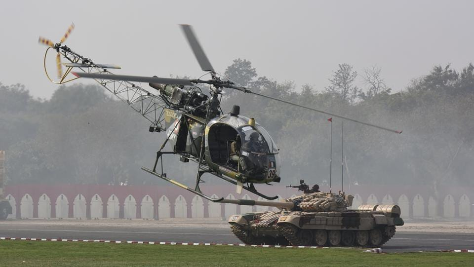 Indian Army helicopter and tank operators during a demonstration of skills. The parade brings out a showcase of the Army's weapon systems and armament arrangement. Both M-777 howitzers and K9 Vajra, which were inducted last year, were showcased at the Army Day parade. (Vipin Kumar / HT Photo)