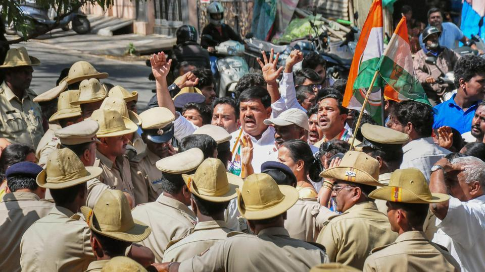 Congress workers protest in front of BJP MLA Ashwath Narayana's house for trying to 'poach' its MLAs in Bengaluru on Wednesday.
