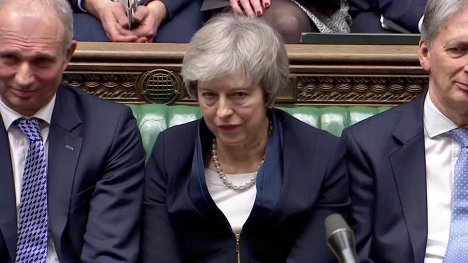 Prime Minister Theresa May sits down in Parliament after the vote on May's Brexit deal, in London, Britain, January 15, 2019 in this screengrab taken from video.