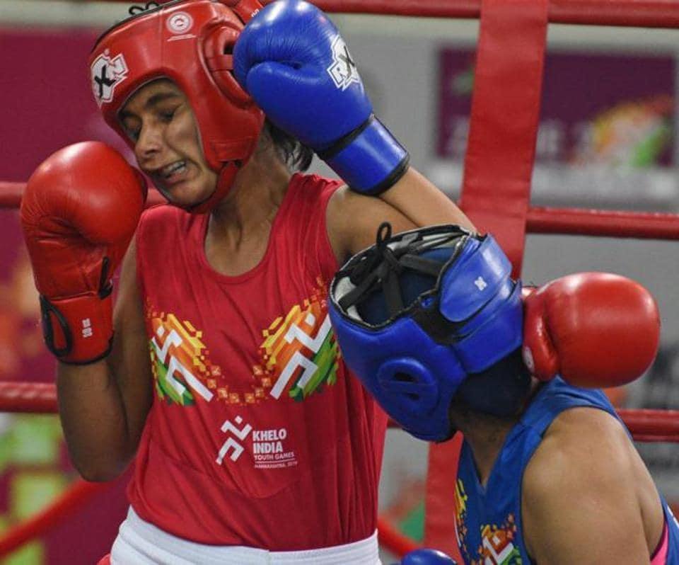 Sanika Sasane (red) of Maharashtra and Lalita of Rajasthan in action during U - 21 Girls Boxing quarter-final at Khelo India Youth Games 2019 at Shiv Chhatrapati sports complex Balewadi on Wednesday. (Pratham Gokhale/HT Photo)