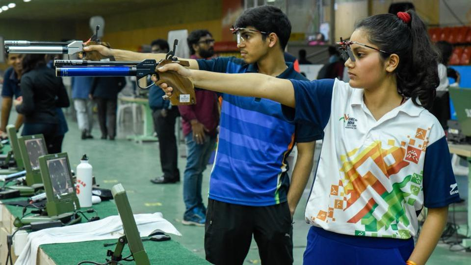 (From right) Priya Raghav and Anmol Jain of Haryana won gold in U-21 10 m Air pistol mixed tea junior event at Khelo India Youth Games 2019 held at Shiv Chhatrapati sports complex, Balewadi on Wednesday. (SANKET WANKHADE/HT PHOTO)