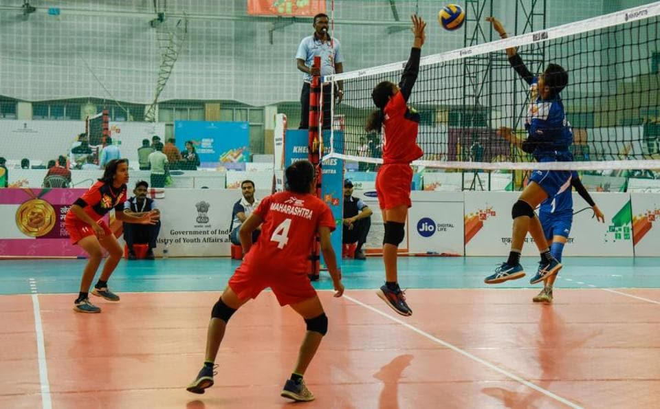 Maharashtra players (red) in action against Gujarat in the U-17 volleyball women match at Khelo India Youth Games 2019 held at Shiv Chhatrapati sports complex, Balewadi on Tuesday. (SANKET WANKHADE/HT PHOTO)